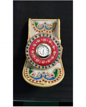 Clock with holder